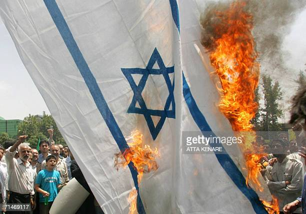 Iranian demonstrators burn a makeshift Israeli flag during a protest in Tehran 18 July 2006 against Israel's military offensive on Lebanon A senior...