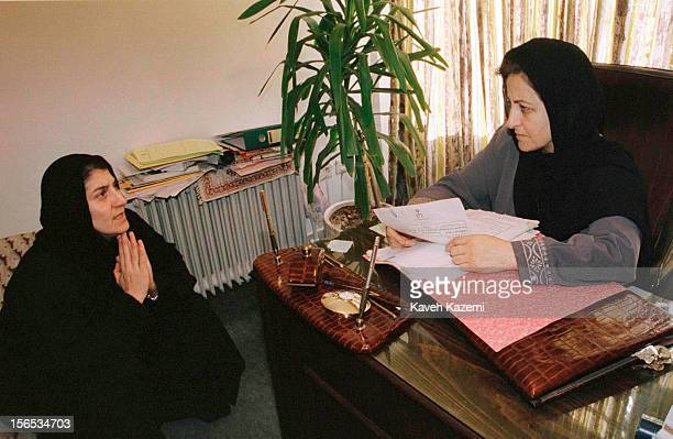Iranian lawyer and activist Shirin Ebadi confers with her client Parastoo Forouhar whose parents were victims of political assassinations by rogue...