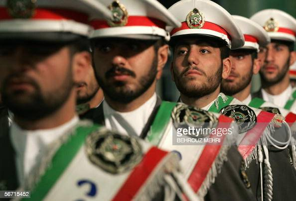 Iranian protocol soldiers stand guard during a ceremony to mark the 27th anniversary of the Islamic revolution at the mausoleum of Iran's late...