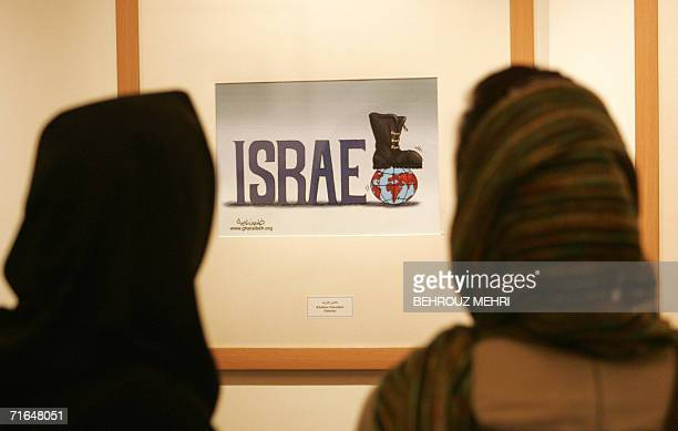 Iranian women look at an antiIsrael cartoon displayed at the international Holocaust cartoon contest in Tehran 14 August 2006 A leading Jewish...