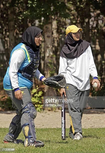 Iranian women meeting the Islamic dress code play a softball game at Tehran's Azadi stadium 15 June 2006 Under the Islamic republic's strict rules...
