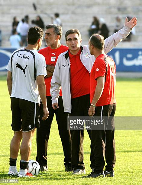 Iran's national football team coach Croatian Branko Ivankovic gestures as his players exercise at their training camp prior to their departure to...