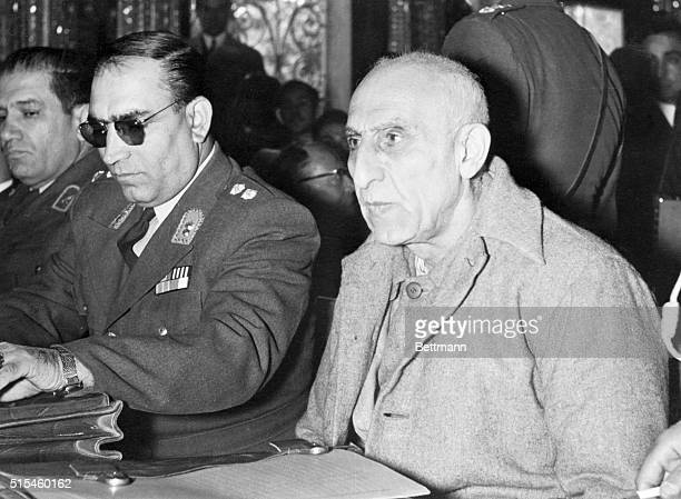 Mossadegh Looks Defiant Seated next to a guard former Iranian Premier Mohammed Mossadegh glances piercingly at the court during his trial in Tehran...