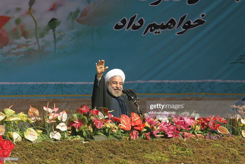 Iranian President Hassan Rouhani delivers a speech during a rally in Tehran's Azadi Square to mark the 35th anniversary of the Islamic revolution on...