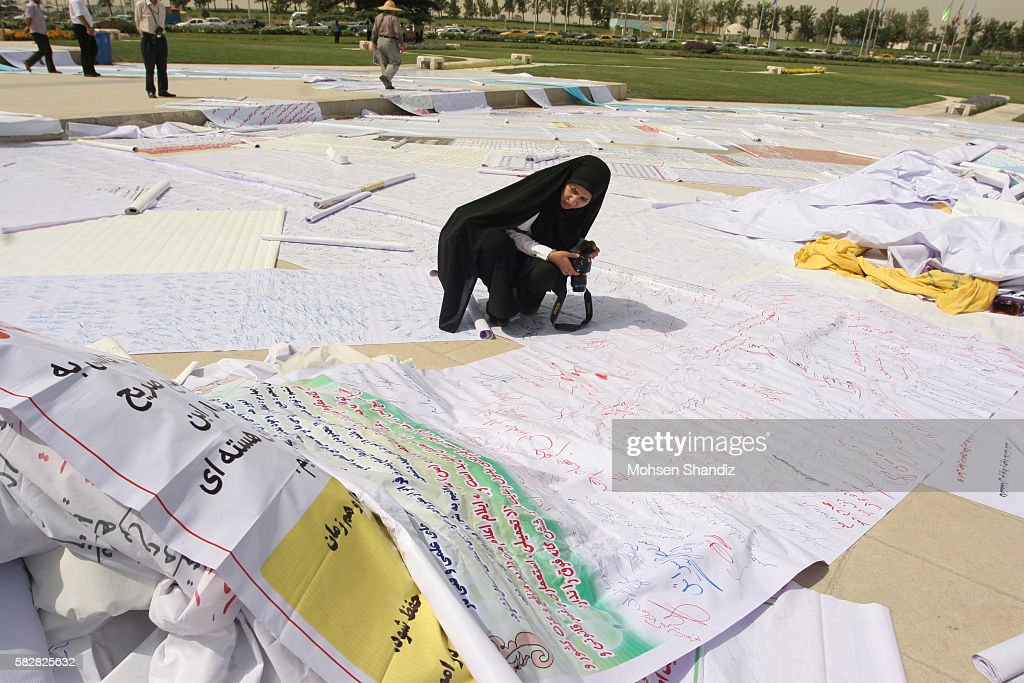 Scrolls of the signed nuclear petition hang from Tehran's Azadi Square on June 30 Corbis PHOTO /Mohsen Shandiz NO 831