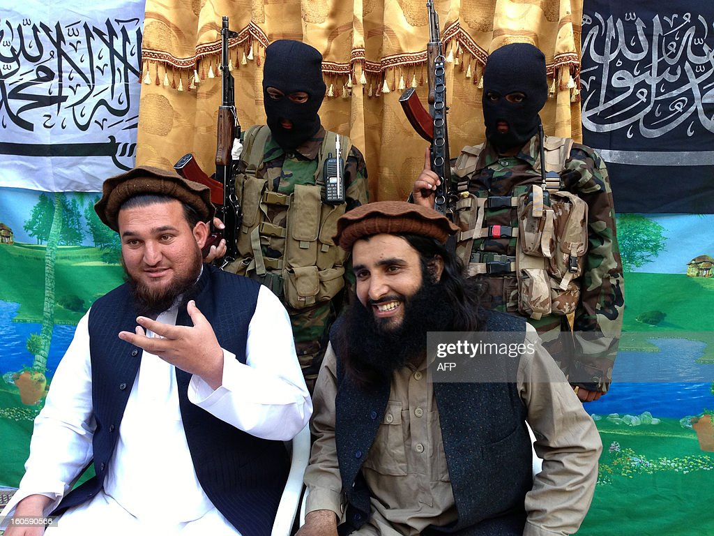 Tehreek-e-Taliban Pakistan (TTP) spokesman Ehsanullah Ehsan (L) and with new TTP member Adnan Rasheed address a press conference in Shabtoi, a village in Pakistan's South Waziristan, on February 2, 2013. The Pakistani Taliban urged the Muslim world to unite in a video message released February 3 as they condemned the French military intervention in Mali as an 'ideological war'. AFP PHOTO/Haji MUSLIM