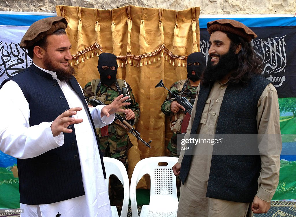 Tehreek-e-Taliban Pakistan (TTP) spokesman Ehsanullah Ehsan (L) talks with new TTP member Adnan Rasheed following a press conference in Shabtoi, a village in Pakistan's South Waziristan, on February 2, 2013. The Pakistani Taliban urged the Muslim world to unite in a video message released February 3 as they condemned the French military intervention in Mali as an 'ideological war'. AFP PHOTO/Haji MUSLIM