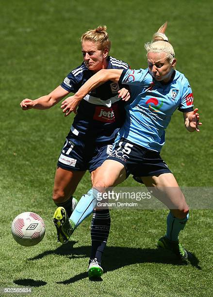 Teigen Allen of Sydney FC and Natasha Dowie of Melbourne Victory contest the ball during the round 11 WLeague match between Melbourne Victory and...