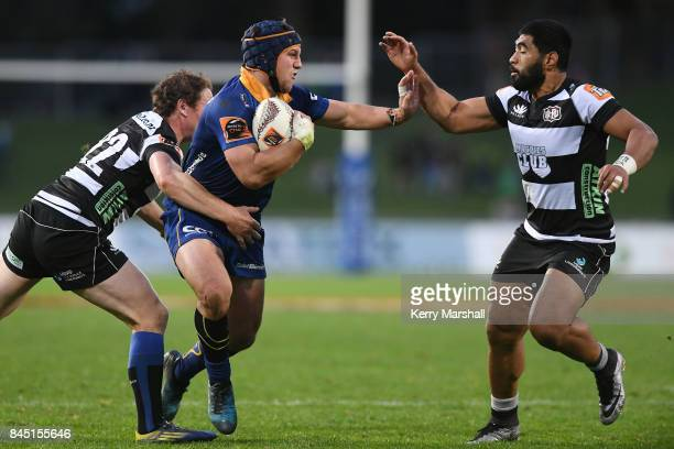 Teihorangi Walden of Otago fends Cardiff Vaega of Hawke's Bay during the round four Mitre 10 Cup match between Hawke's Bay and Otago at McLean Park...