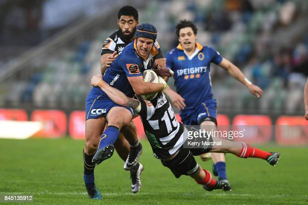 Teihorangi Walden of Otago is tackled by Richard Buckman of Hawke's Bay during the round four Mitre 10 Cup match between Hawke's Bay and Otago at...