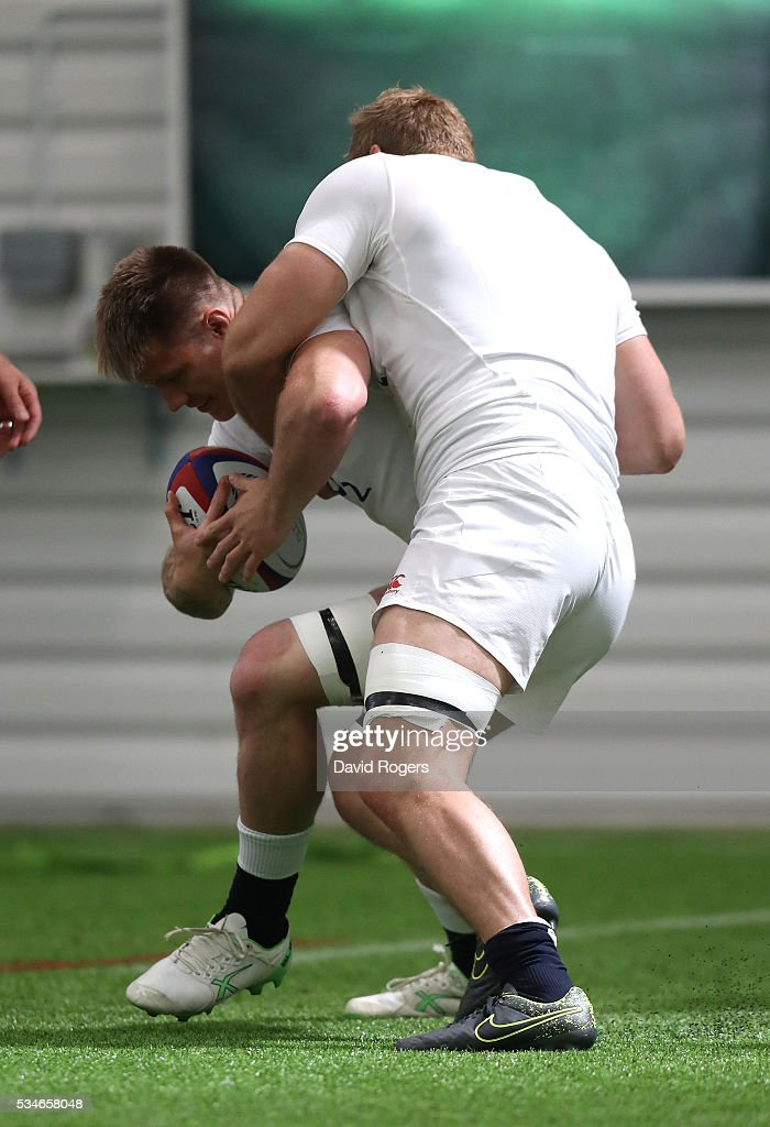 Teimana Harrison is held by <a gi-track='captionPersonalityLinkClicked' href=/galleries/search?phrase=James+Haskell&family=editorial&specificpeople=539694 ng-click='$event.stopPropagation()'>James Haskell</a> during the England training session held at Pennyhill Park on May 27, 2016 in Bagshot, England.