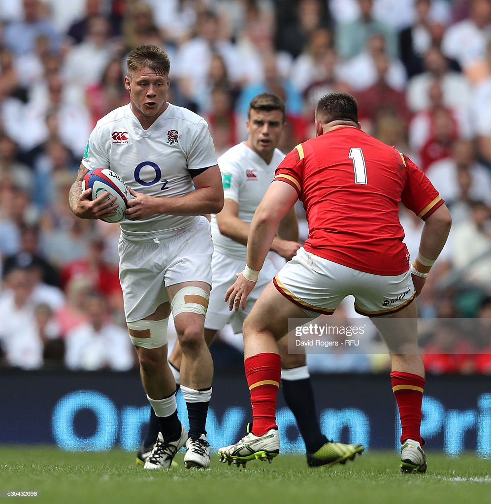 Teimana Harrison of England takes on Rob Evans during the England v Wales International match at Twickenham Stadium on May 29, 2016 in London, England.