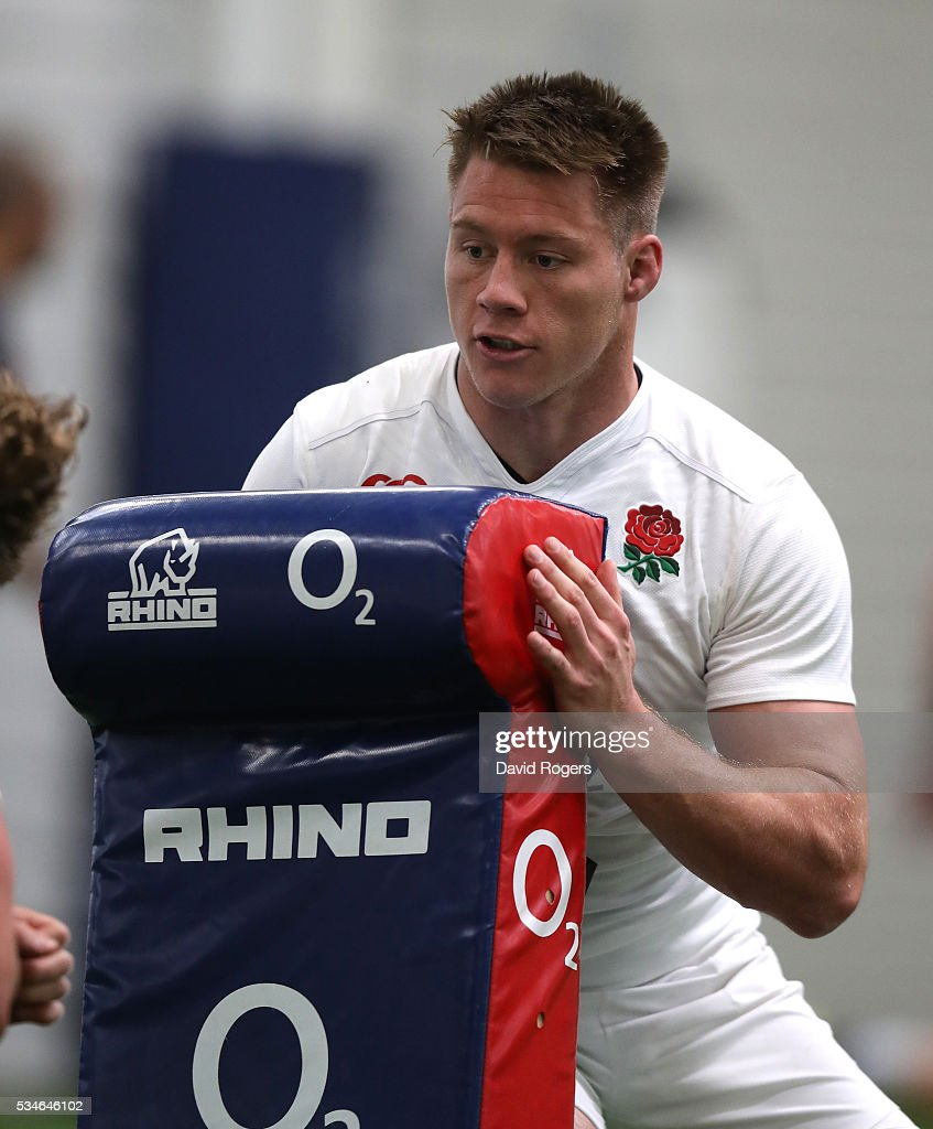 Teimanan Harrison, who will make his full international debut against Wales on Sunday, holds a tackle bag during the England training session held at Pennyhill Park on May 27, 2016 in Bagshot, England.