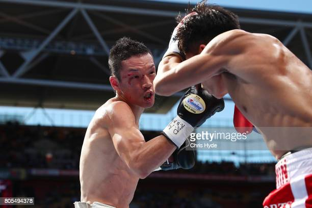 Teiru Kinoshita of Japan and Jerwin Ancajas of the Philippines exchange punches during their IBF World Junior Bantamweight Titale ahead of the WBO...