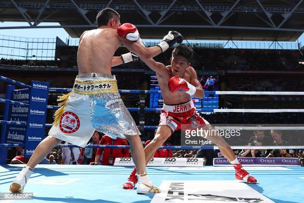 Teiru Kinoshita of Japan and Jerwin Ancajas of thePhilippines exchange punches during their IBF World Junior Bantamweight Titale ahead of the WBO...