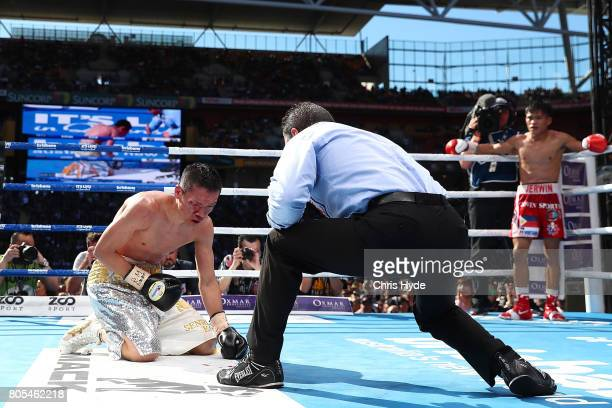 Teiru Kinoshita of Japan is knocked down by Jerwin Ancajas of the Philippines during their IBF World Junior Bantamweight Titale ahead of the WBO...