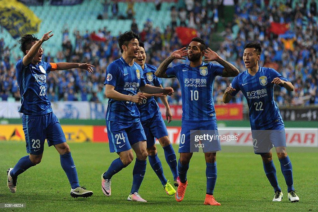 Teixeira #10 of Jiangsu Suning celebrates a ball with teammates during the AFC Asian Champions League match between Jeonbuk Hyundai Motors FC and Jiangsu Suning FC at Jeonju World Cup Stadium on May 4, 2016 in Jeonju, South Korea.