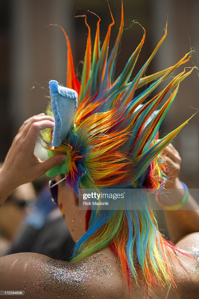 Teiya Kasahara adjusts her headpiece which is part of her rainbow hair. Pride Toronto Dyke March works its way through the downtown core as marchers celebrate Pride Toronto festivities, on Saturday, June 29, 2013. The larger extravaganza of the Pride Parade is set for Sunday.
