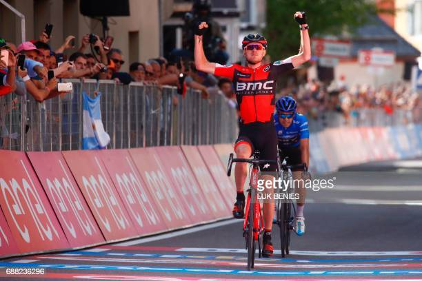 US Tejay Van Garderen of team BMC celebrates as he crosses the finish line ahead Spain's Mikel Landa of team Sky to win the 18th stage of the 100th...