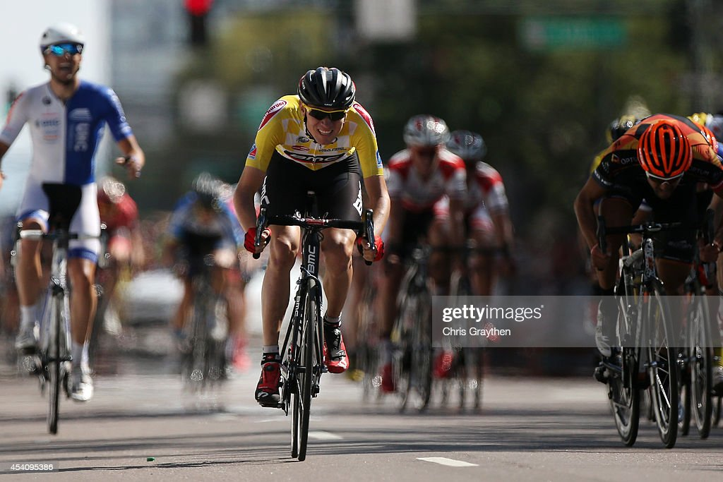 Tejay van Garderen of the United States riding for the BMC Racing Team in the yellow leader's jersey sprints to the finish line at the end of the final stage of the 2014 USA Pro Challenge from Boulder to Denver on August 24, 2014 in Denver, Colorado.