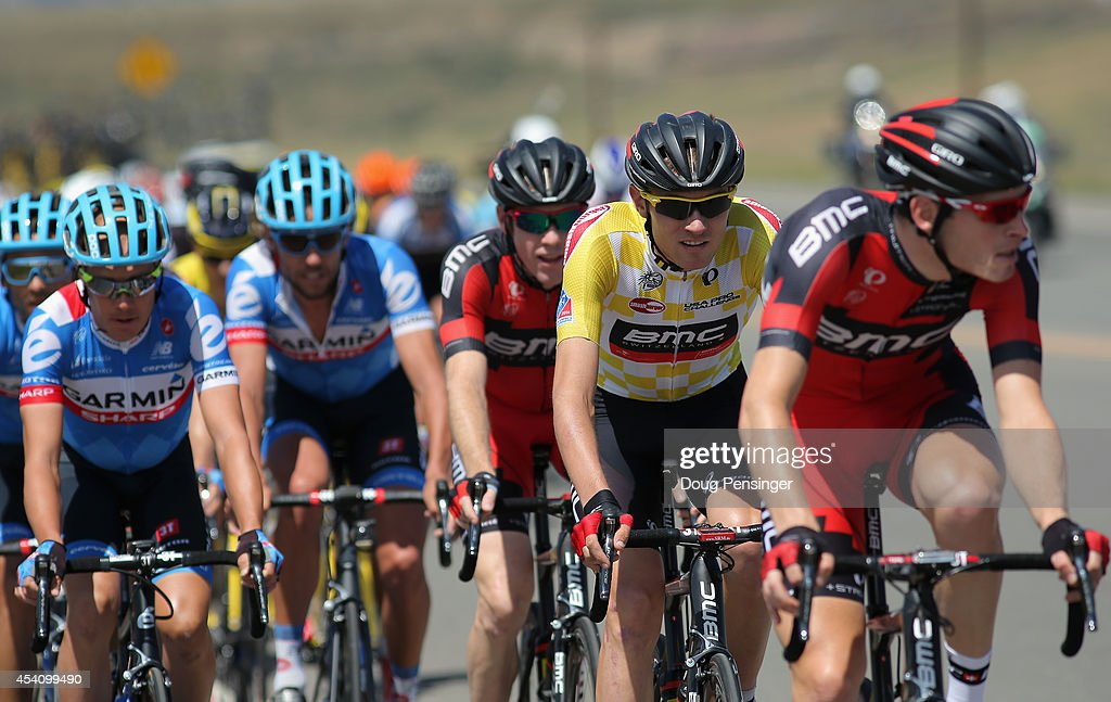 Tejay van Garderen (2R) of the United States riding for the BMC Racing Team defends the overall race leader's yellow jersey with the help of his teammates against second place finisher <a gi-track='captionPersonalityLinkClicked' href=/galleries/search?phrase=Tom+Danielson&family=editorial&specificpeople=224809 ng-click='$event.stopPropagation()'>Tom Danielson</a> (L) of the United States riding for Garmin Sharp as they ride in the peloton during stage seven of the 2014 USA Pro Cycling Challenge from Boulder to Denver on August 24, 2014 in Denver, Colorado.