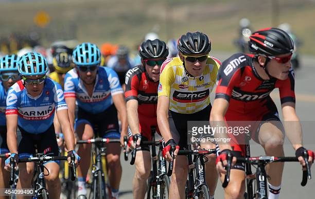 Tejay van Garderen of the United States riding for the BMC Racing Team defends the overall race leader's yellow jersey with the help of his teammates...
