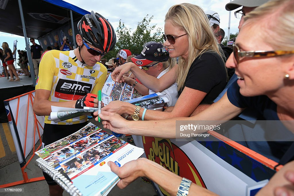Tejay van Garderen of the USA riding for BMC Racing signs autographs for fans at the start as he went on to defend the overall race leader's yellow jersey during stage six of the 2013 USA Pro Challenge from Loveland to Fort Collins on August 24, 2013 in Loveland, Colorado.