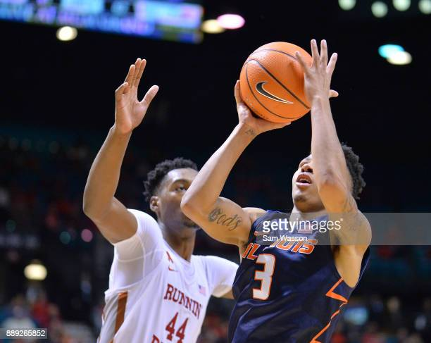 Te'Jon Lucas of the Illinois Fighting Illini drives in for a layup against Brandon McCoy of the UNLV Rebels during their game at the MGM Grand Garden...