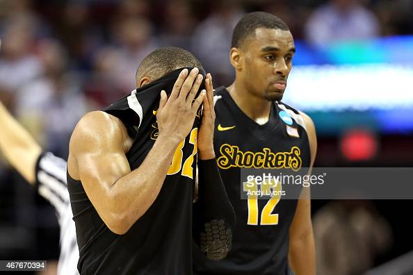 Tekele Cotton and Darius Carter of the Wichita State Shockers walk off the court late in the game against the Notre Dame Fighting Irish during the...