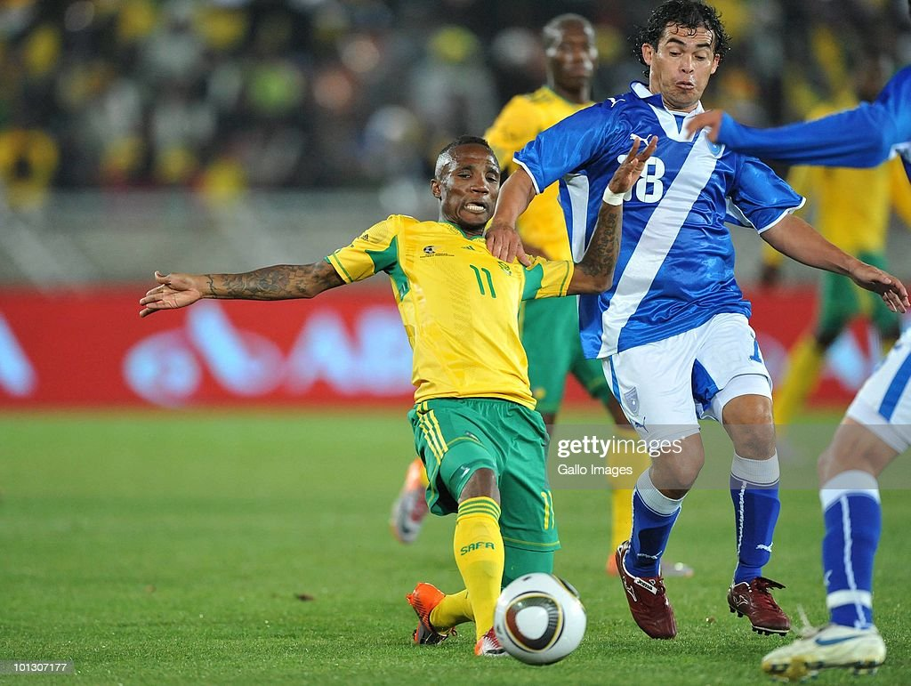 Teko Modise of South Africa is challenged by Sergio Guevara of Guatamala during the International Friendly match between South Africa and Guatemala at the Peter Mokaba Stadium on May 31, 2010 in Polokwane, South Africa.