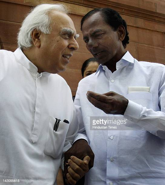 Telagana Rashtra Samiti leader K Chandrasekhara talks with HRD Minister Kapil Sibal at parliament house during the budget session on March 28 2012 in...