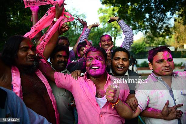 Telangana Rashtra Samiti supporters celebrating after Telangana Bill passed in Lok Sabha on February 18 2014 in New Delhi India
