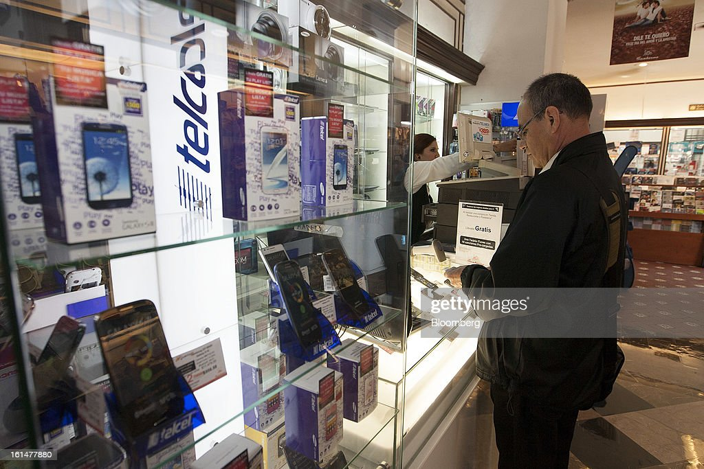 A Telcel client pays for his mobile phone services inside a Grupo Sanborns SAB store in Mexico City, Mexico, on Friday, Feb. 8, 2013. Grupo Sanborns SAB, the retailer controlled by Mexican billionaire Carlos Slim, raised 10.5 billion pesos ($825 million) in an initial public offering (IPO) last week and the total could climb to 12.1 billion pesos including an overallotment option for underwriters. Photographer: Susana Gonzalez/Bloomberg via Getty Images