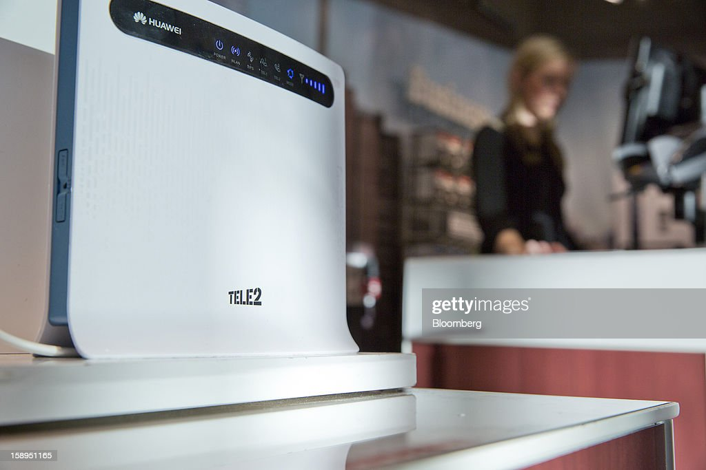 A Tele2 logo sits on a Huawei Technologies Co. 4G internet router device displayed inside a Tele2 AB retail store at the Farsta Centrum shopping center in Stockholm, Sweden, on Friday, Jan. 4, 2013. OAO Rostelecom's largest owner after the Russian state, Konstantin Malofeev, is urging the country's dominant fixed-line operator to buy the local unit of Sweden's Tele2 AB to form a fourth nationwide wireless carrier. Photographer: Casper Hedberg/Bloomberg via Getty Images