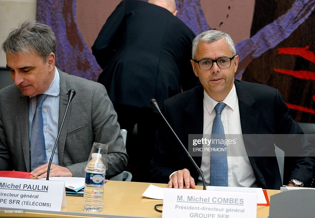 Telecom Company Altice N.V group CEO and CEO of SFR Michel Combes (R) and CEO of SFR group in charge of Telecoms activities Michel Paulin attend their hearing by the Economic Affairs Committee of the French National Assembly in Paris on June 29, 2016. / AFP / ERIC