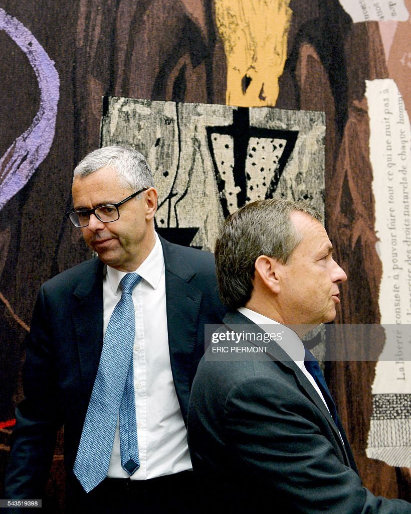 Telecom Company Altice N.V group CEO and CEO of SFR Michel Combes (L) and President of the NextRadioTV group and CEO of SFR group in charge of Media activities Alain Weill arrive to attend their hearing by the Economic Affairs Committee of the French National Assembly in Paris on June 29, 2016. / AFP / ERIC