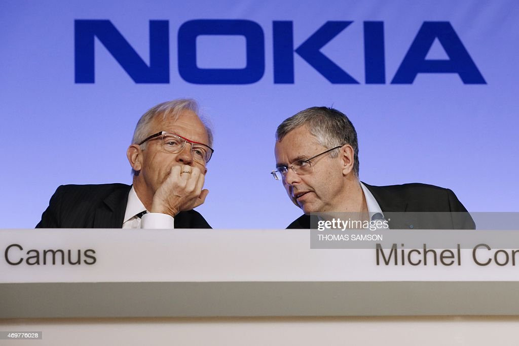 Telecom equipment maker Alcatel-Lucent's chairman of the supervisory board Philippe Camus (L) and Telecom equipment maker Alcatel-Lucent's Chief Executive Officer <a gi-track='captionPersonalityLinkClicked' href=/galleries/search?phrase=Michel+Combes&family=editorial&specificpeople=6531244 ng-click='$event.stopPropagation()'>Michel Combes</a> (R) give a press conference, on April 15, 2015 in Paris, to formalise the merger of Nokia and Alcatel-Lucent. Nokia has struck a 15.6-billion-euro deal to buy its rival Alcatel-Lucent to create the world's biggest supplier of mobile phone network equipment. The merger of two companies will produce a European champion able to take on Nokia's Swedish rival Ericsson or fierce Chinese competition.