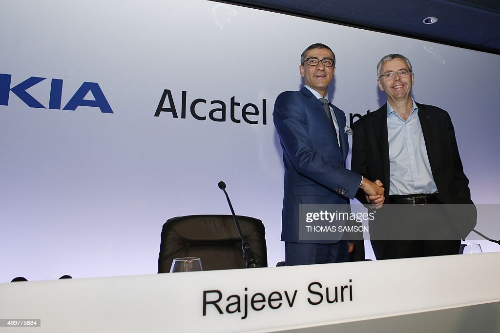 Telecom equipment maker Alcatel-Lucent's Chief Executive Officer <a gi-track='captionPersonalityLinkClicked' href=/galleries/search?phrase=Michel+Combes&family=editorial&specificpeople=6531244 ng-click='$event.stopPropagation()'>Michel Combes</a> (L) and Nokia's Chief Executive <a gi-track='captionPersonalityLinkClicked' href=/galleries/search?phrase=Rajeev+Suri&family=editorial&specificpeople=7403666 ng-click='$event.stopPropagation()'>Rajeev Suri</a> shake hands during a press conference, on April 15, 2015 in Paris, to formalise the merger of the two companies. Nokia has struck a 15.6-billion-euro deal to buy its rival Alcatel-Lucent to create the world's biggest supplier of mobile phone network equipment. The merger of two companies will produce a European champion able to take on Nokia's Swedish rival Ericsson or fierce Chinese competition.