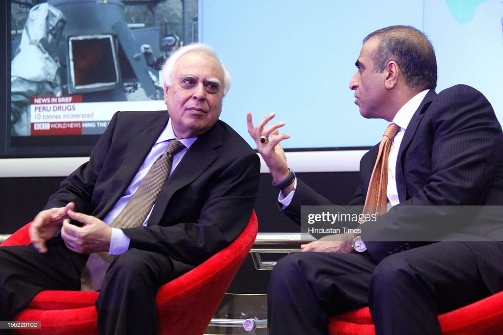 Telecom Minister <a gi-track='captionPersonalityLinkClicked' href=/galleries/search?phrase=Kapil+Sibal&family=editorial&specificpeople=791656 ng-click='$event.stopPropagation()'>Kapil Sibal</a> and Bharti Airtel Chairman Sunil Bharti Mittal during during launch of network experience centre (NEC) at Manesar on on October 31, 2012 in Gurgaon, India. Network Experience Centre (NEC) will monitor its various services like mobile, fixed line and DSL broadband, DTH, M-commerce, enterprise, international cable systems and internet peering points across India and South Asia from a single location.