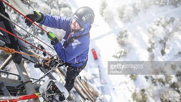 Telecommunication manual high worker engineer climbing an antenna