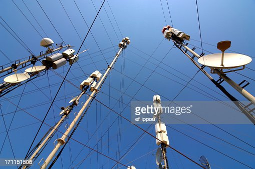 Telecommunication masts and satellites seen from below