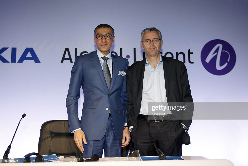 Telecommunications company Alcatel-Lucent's Chief Executive Officer <a gi-track='captionPersonalityLinkClicked' href=/galleries/search?phrase=Michel+Combes&family=editorial&specificpeople=6531244 ng-click='$event.stopPropagation()'>Michel Combes</a> (R) and multinational communications Nokia's Chief Executive <a gi-track='captionPersonalityLinkClicked' href=/galleries/search?phrase=Rajeev+Suri&family=editorial&specificpeople=7403666 ng-click='$event.stopPropagation()'>Rajeev Suri</a> (L) pose after a press conference, on April 15, 2015 in Paris, France. <a gi-track='captionPersonalityLinkClicked' href=/galleries/search?phrase=Michel+Combes&family=editorial&specificpeople=6531244 ng-click='$event.stopPropagation()'>Michel Combes</a> and <a gi-track='captionPersonalityLinkClicked' href=/galleries/search?phrase=Rajeev+Suri&family=editorial&specificpeople=7403666 ng-click='$event.stopPropagation()'>Rajeev Suri</a> have formalised the merger of the two companies after Nokia struck a 15.6-billion-euro deal to buy its rival Alcatel-Lucent to create the world's biggest supplier of mobile phone network equipment.