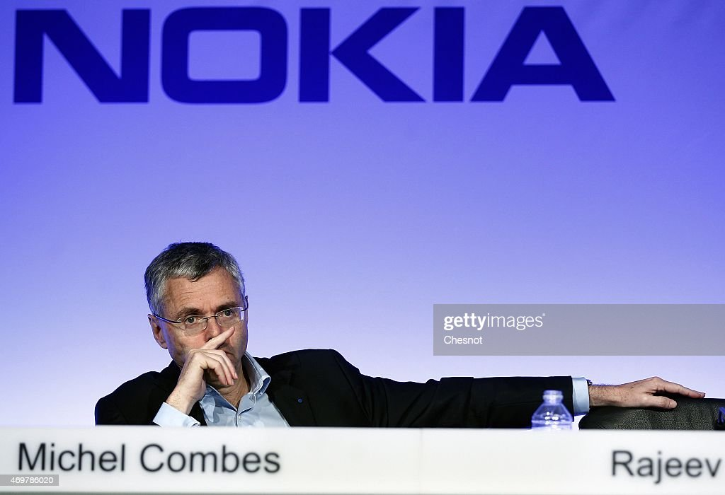 Telecommunications company Alcatel-Lucent's Chief Executive Officer <a gi-track='captionPersonalityLinkClicked' href=/galleries/search?phrase=Michel+Combes&family=editorial&specificpeople=6531244 ng-click='$event.stopPropagation()'>Michel Combes</a> attends a press conference, on April 15, 2015 in Paris, France. <a gi-track='captionPersonalityLinkClicked' href=/galleries/search?phrase=Michel+Combes&family=editorial&specificpeople=6531244 ng-click='$event.stopPropagation()'>Michel Combes</a> and Rajeev Suri have formalised the merger of the two companies after Nokia struck a 15.6-billion-euro deal to buy its rival Alcatel-Lucent to create the world's biggest supplier of mobile phone network equipment.