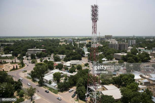 A telecommunications mast stands among residential buildings in N'Djamena Chad on Wednesday Aug 16 2017 African Development Bank and nations signed...