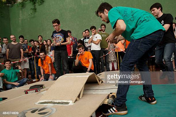 Telecommunications student Ruben Espino competes with enginnering student Carlos Hucha during a sumo robots combat during the Cybertech robotics...