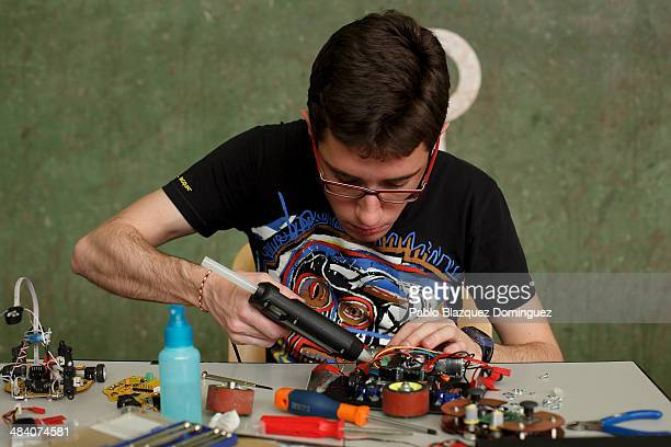 Telecommunications student Ruben Espino works on his robot 'Kassius' before a sumo robots combat during the Cybertech robotics competition at the the...