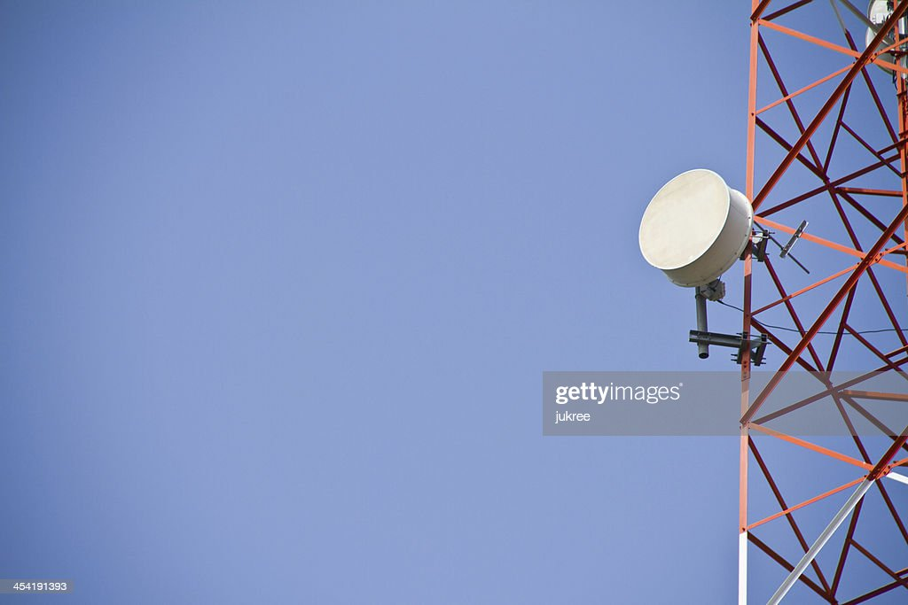 Telecommunications tower. Mobile phone base station : Stock Photo