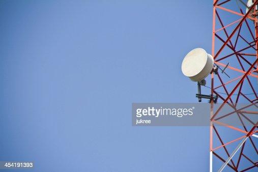 Telecommunications tower. Mobile phone base station : Stock Photo