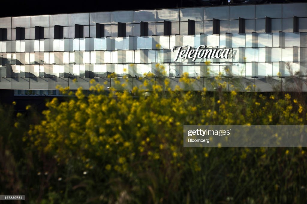 A Telefonica logo sits illuminated by light outside the headquarters of Telefonica SA in Madrid, Spain, on Tuesday, April 30, 2013. Telefonica SA, Spain's largest phone company, is considering sale options in Europe that range from fixed-line operations in Germany to its assets in Ireland, according to people familiar with the plans. Photographer: Angel Navarrete/Bloomberg via Getty Images