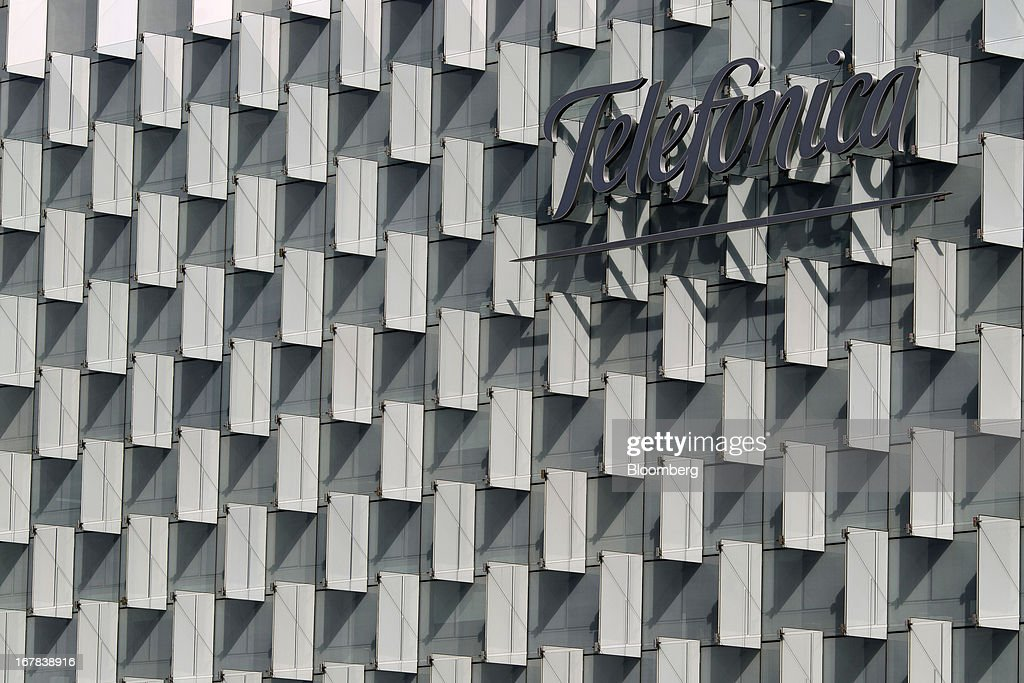 A Telefonica logo sits on display outside the headquarters of Telefonica SA in Madrid, Spain, on Tuesday, April 30, 2013. Telefonica SA, Spain's largest phone company, is considering sale options in Europe that range from fixed-line operations in Germany to its assets in Ireland, according to people familiar with the plans. Photographer: Angel Navarrete/Bloomberg via Getty Images